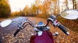 Close-up of motorcycle on road in autumn